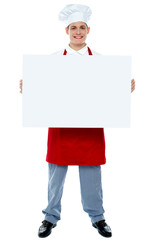 Chef holding blank advertising board