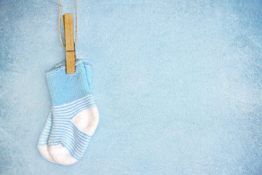 Blue baby socks on a textured background