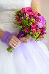 Bride with bouquet, closeup