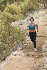 Hispanic runner training in remote area