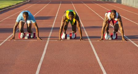 Black runners at starting block in race