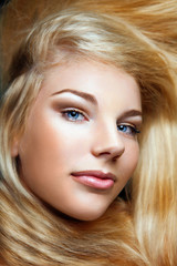 young beautiful girl with long blond hair and stylish make-up