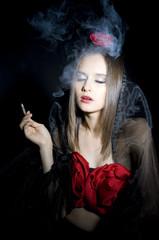 Portrait smokes women is spain costume