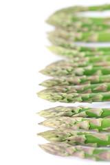 Green asparagus border on white background
