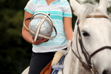 Woman playing horse ball
