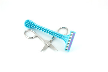 Blue razors for woman and scissors over white