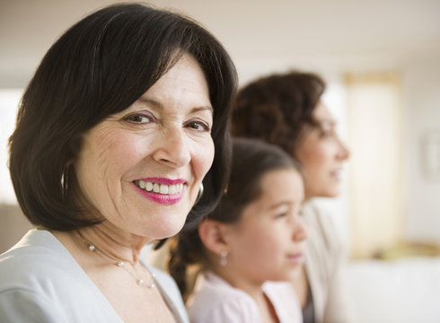 Smiling woman with family