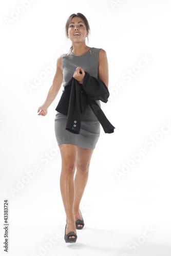 """Self confident young executive woman, walking towards ..."