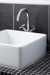 Sink tap in contemporary bathroom