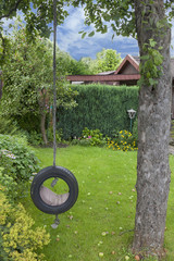 playground with a selfmade garden swing hanging on a tree