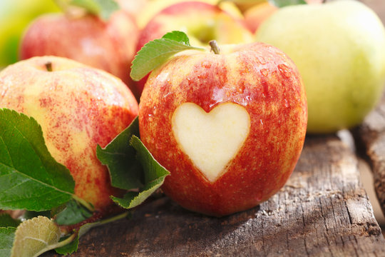 Fresh red apple with heart cutout