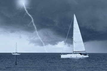 sailing boats in the sea under cloudy sky