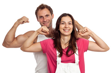 Young couple flexing biceps over white background