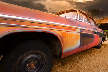 Fotobehang Route 66 Colorful old rustic car body along route 66