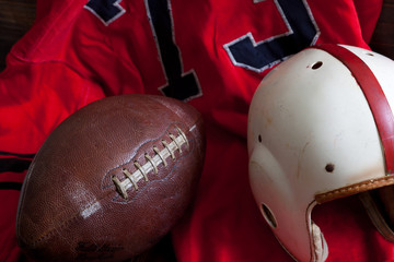 A group of vintage American football equipment