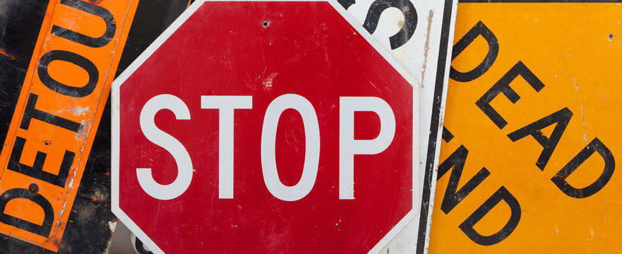 A group of assorted vintage traffic signs forming a background