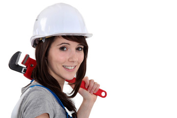 Woman resting wrench on shoulder
