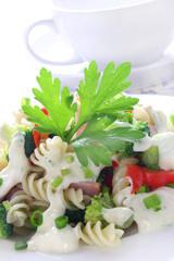 Pasta with broccoli, ham and garlic sauce