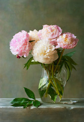 Bouquet of peonies in a glass jar