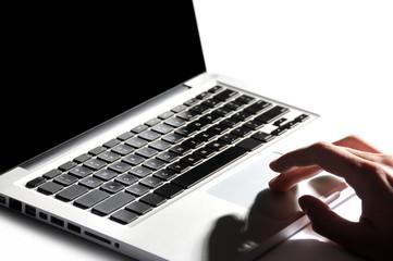 Fototapeta Male hand typing on laptop