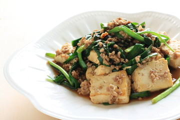 Chinese cuisine, Tofu and mince stir fried on white background