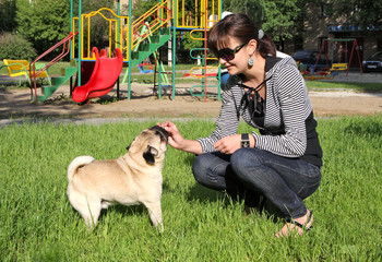 Dog Pug and young woman