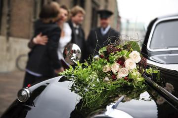 Beautiful bridal bouquet on car bonnet