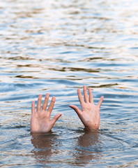 Female hands protruding from the water surface