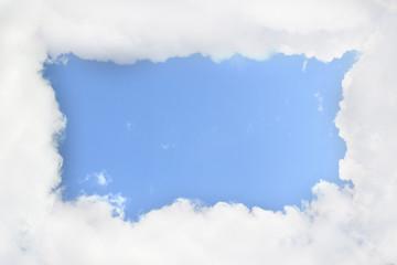 Cloudy frame in blue sky