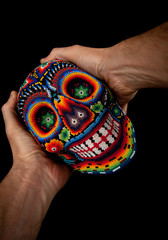 Beaded skull with hands