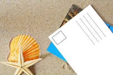 blank postcard on sand
