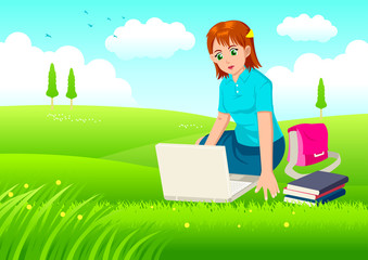 A woman working on laptop on grass field