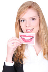 Woman holding photo of mouth