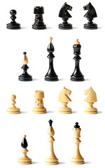 Detail of wooden chess pieces isolated on white background
