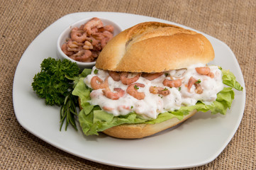 Shrimps on a roll (wooden background)
