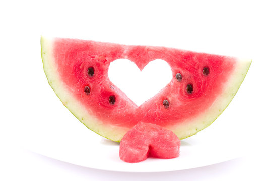 Watermelon with heart isolated on white background