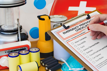 Hand completing Emergency Preparation List by Equipment Wall mural