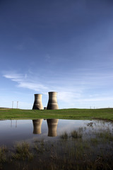 Reflection of idle nuclear power towers.