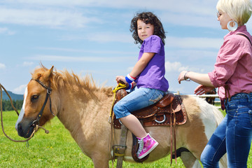 child ride pony