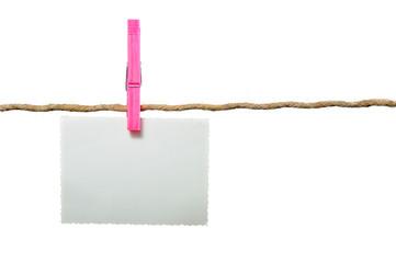 Blank Photo Hanging on Rope on White Background