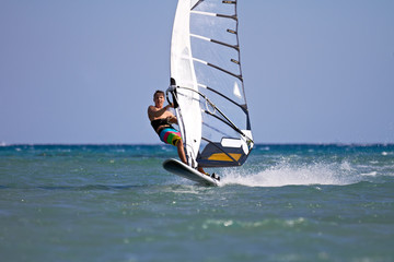 Windsurfer starting a jump