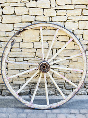 Old Vintage broken wood wheel in Provence, traditional wall back