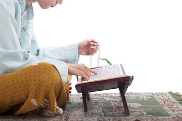 Asian Muslim reading Koran in Ramadan