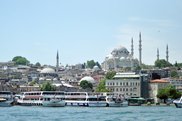 Cruise ferries in Eminonu Port near Yeni Cami on June