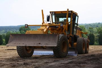 Véhicule niveleuse chantier travaux publics