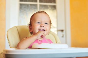 laughing eating baby girl