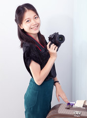 woman and camera in hand