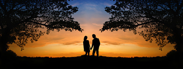 The image of two romantic people in love standing at the sunset