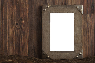 Blank dark brown wooden frame with rusty edges