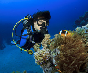 Woman Scuba Diver finds Nemo